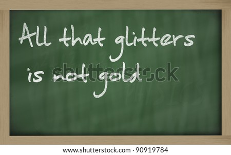 Blackboard writings all that glitters is not gold - stock photo