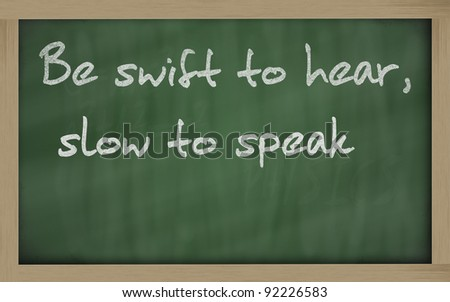 """Blackboard writings """" be swift to hear, slow to speak """" - stock photo"""