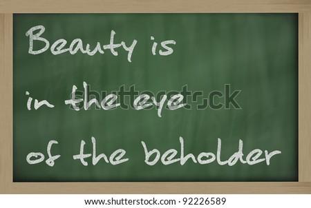 """Blackboard writings """" Beauty is in the eye of the beholder """" - stock photo"""