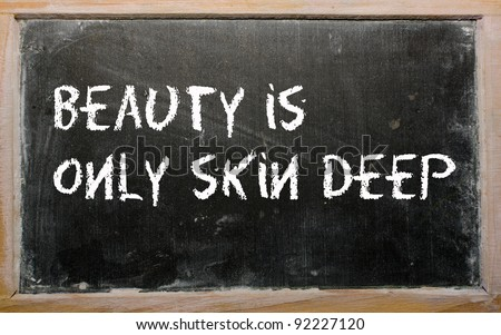 "Blackboard writings ""Beauty is only skin deep"" - stock photo"