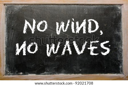 "Blackboard writings ""No wind, no waves"" - stock photo"
