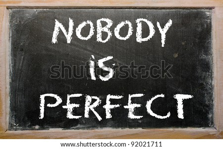"Blackboard writings ""Nobody is perfect"" - stock photo"