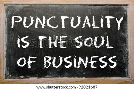 "Blackboard writings ""Punctuality is the soul of business"""
