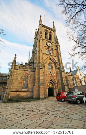 BLACKBURN, UK - FEBRUARY 3 2016: Blackburn Cathedral. Blackburn is a large town in Lancashire, England which lies to the north of the West Pennine Moors on the southern edge of the Ribble Valley, - stock photo