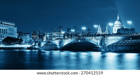 Blackfriars Bridge and St Pauls Cathedral in London at night. - stock photo