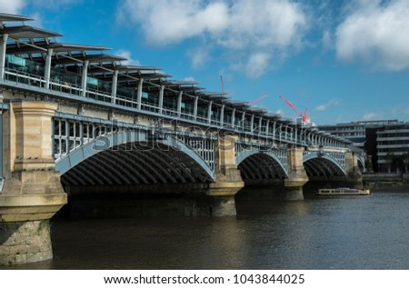 Blackfriars Station and Bridge seen from the south side of the River Thames in London on a summer morning.