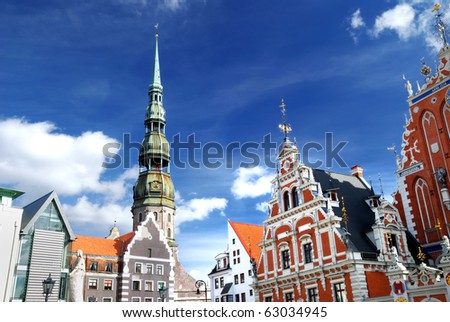 Blackhead's house and Saint Peters church in old city part of Riga, Latvia - stock photo
