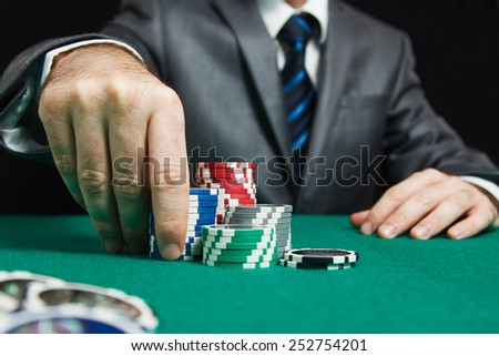 Blackjack At Casino, Man Makes A Bet - stock photo