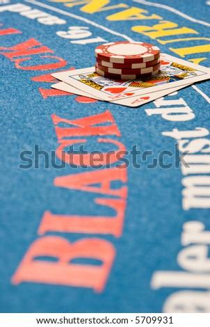 Blackjack hand on a blackjack table - stock photo