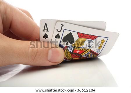 Blackjack. Human hand with blackjack cards over white - stock photo