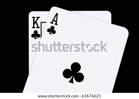 Blackjack In Spades -- A winning blackjack have, a  King and Ace of Spades, against a clean black background - stock photo