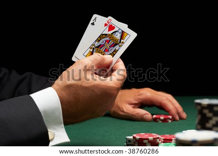Blackjack player winning hand of cards and casino chips - stock photo