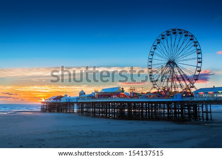 Blackpool Central Pier and Ferris Wheel, Lancashire, UK - stock photo