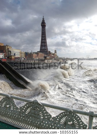 Blackpool promenade and tower in a storm - stock photo