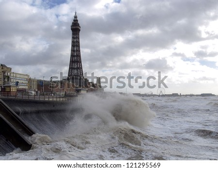 Blackpool tower and stormy sea - stock photo