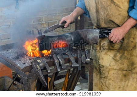 blacksmith at work in the repair shop in italy