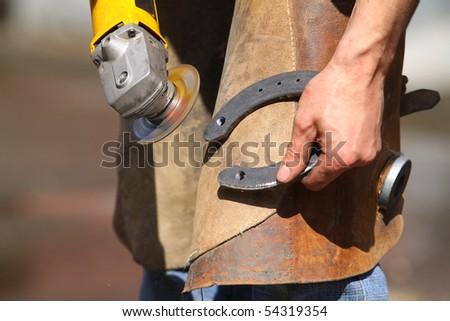 Blacksmith making horseshoes - stock photo