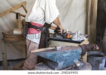 Blacksmith old-fashioned way of making articles of iron