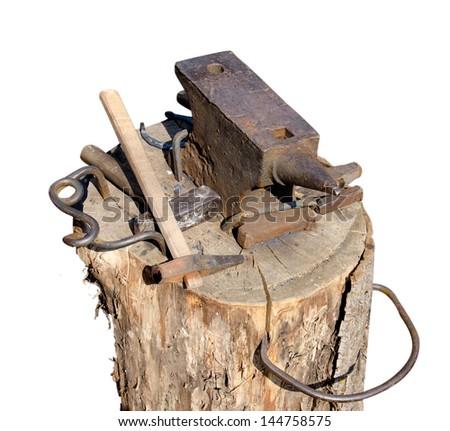 Blacksmith's tools isolated on white background - stock photo