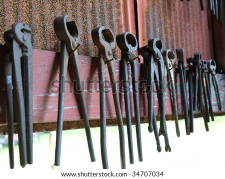 blacksmith tools hanging on wall