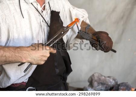 Blacksmith vitange way of making articles of iron - stock photo