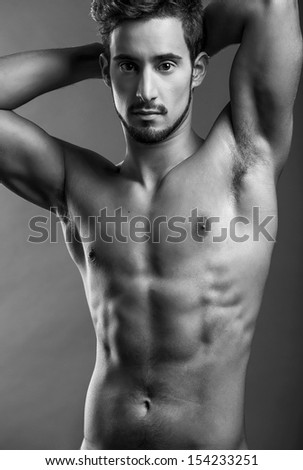 Blacl and White portrait of a Shirtless male model posing - stock photo