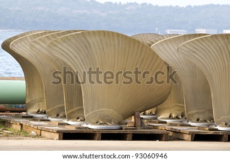 blades of big propellers ready for new ship - stock photo
