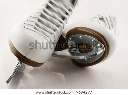 Blades of white figure skates. - stock photo