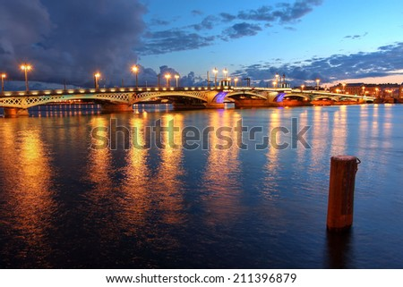 Blagoveschchenskiy Bridge over the Neva River in Saint Petersburg, Russia during a dramatic sunset. - stock photo