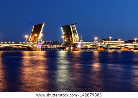 Blagoveschchenskiy Bridge over the Neva River in Saint Petersburg, Russia in it's open position during the white nights of June. - stock photo