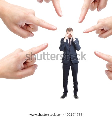 Blaming a businessman - stock photo