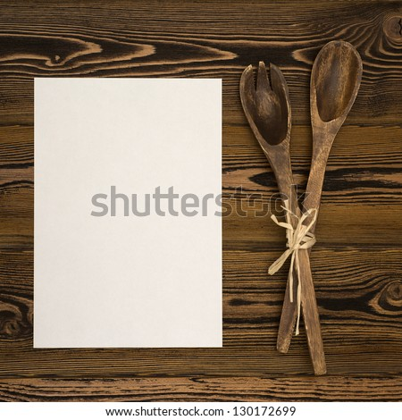 Blanc paper on rustic wooden background - stock photo