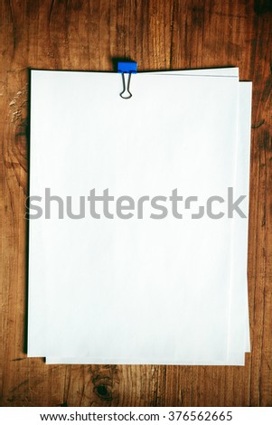 Blank A4 white paper on office desk, top view as mock up copy space for business report or plan. - stock photo
