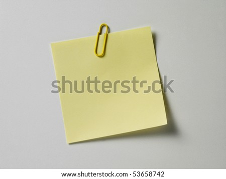 blank adhesive note with paper clip - stock photo