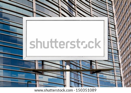 Blank advertising billboard and glass windows in office building - stock photo