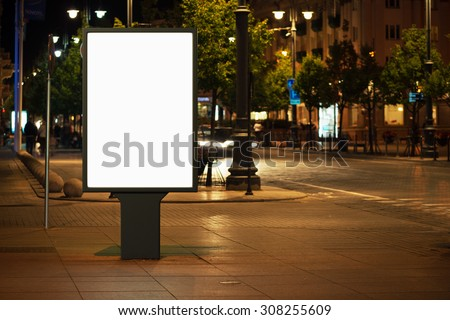 Blank advertising billboard in the city at night. - stock photo