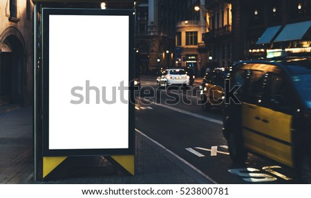 Blank advertising light box on bus stop, mockup of empty ad billboard on night bus station, template banner on background city street for text in Barcelona, afisha board and headlights of taxi cars