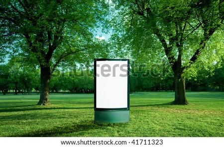 Blank advertising panel in park - stock photo