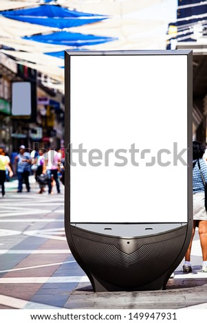 Blank Advertising Panel on a Crowded Street - stock photo