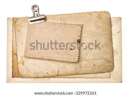 Blank aged paper sheets with metal clip isolated on white background. Used cardboard - stock photo