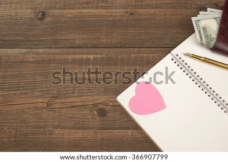 Blank And Empty Spiral Notepad Or Notebook Page, Pink Paper Hearts, Make Wallet On Rough Wood Table Background - stock photo