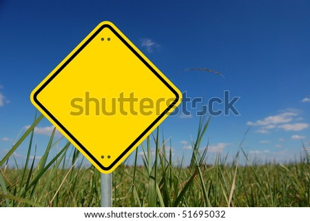 blank and empty yellow road sign with copyspace - stock photo