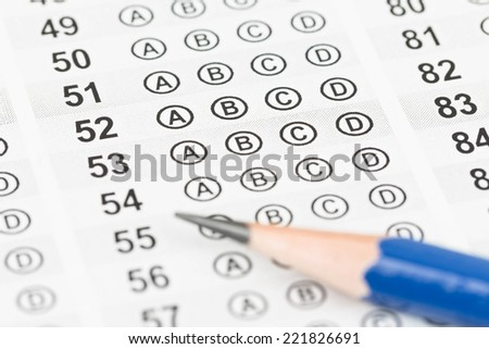 Blank answer sheet with pencil - stock photo