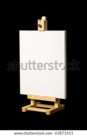blank artist's canvas on wooden easel isolated on black background. Place your own artwork or ad or text. - stock photo