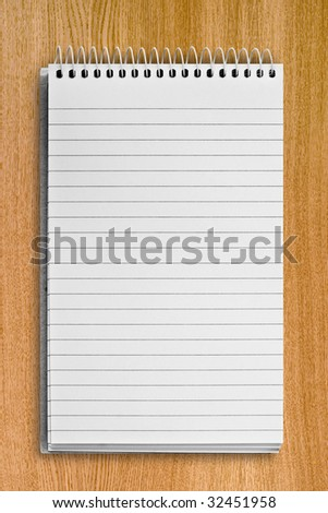 blank background. paper spiral notebook over wood