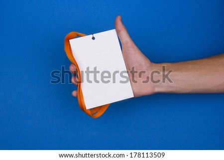 Blank badge on blue background - stock photo