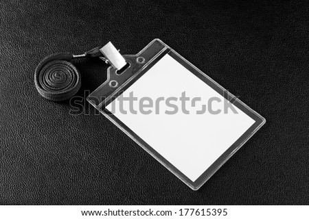 Blank badge with neckband on background leather texture - stock photo