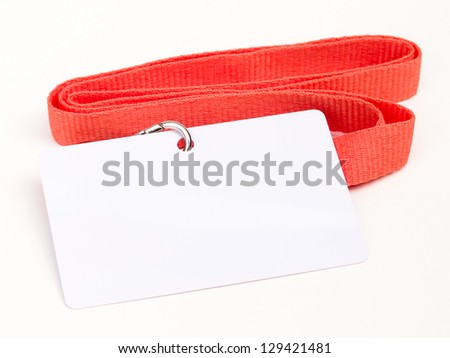 Blank badge with red cord on white background - stock photo