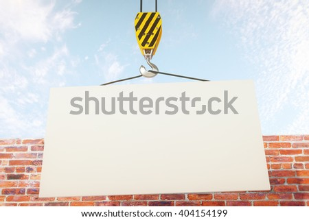 Blank banner on crane hook with clear sky and brick wall in the background. Mock up, 3D Rendering - stock photo