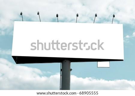 Blank big billboard over blue cloudy sky - stock photo